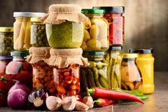 Jars with variety of pickled vegetables. royalty free stock image