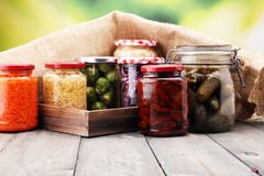 Jars with variety of pickled vegetables. Preserved food. Jars with variety of pickled vegetables. Preserved food Royalty Free Stock Images