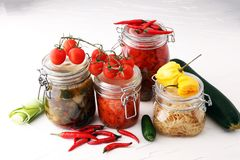 Jars with variety of pickled vegetables. Preserved food.  Stock Images