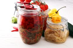 Jars with variety of pickled vegetables. Preserved food.  Stock Image