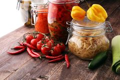 Jars with variety of pickled vegetables. Preserved food.  Stock Photo