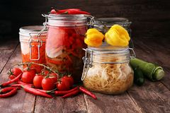 Jars with variety of pickled vegetables. Preserved food royalty free stock image