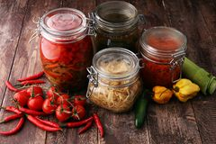Jars with variety of pickled vegetables. Preserved food.  Royalty Free Stock Images