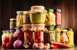 Jars with variety of pickled vegetables. Royalty Free Stock Images