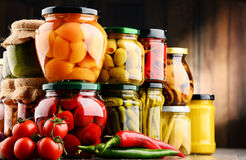 Jars with variety of pickled vegetables. Preserved food Royalty Free Stock Photo