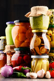 Jars with variety of pickled vegetables. Stock Photos