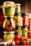 Jars with variety of pickled vegetables. Royalty Free Stock Photography