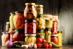 Jars with variety of pickled vegetables. Stock Photography