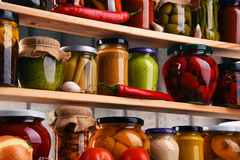 Jars with variety of pickled vegetables. stock image