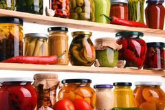 Jars with variety of pickled vegetables. Preserved food Stock Photos