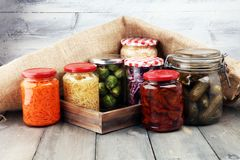 Jars with variety of pickled vegetables. Preserved food. Jars with variety of pickled vegetables. Preserved food Stock Image