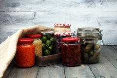 Jars with variety of pickled vegetables. Preserved food. Jars with variety of pickled vegetables. Preserved food Royalty Free Stock Photography