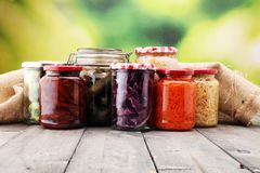 Jars with variety of pickled vegetables. Preserved food. Jars with variety of pickled vegetables. Preserved food Royalty Free Stock Image