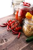 Jars with variety of pickled vegetables. Preserved food.  Stock Photography