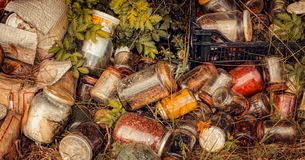 Jars of various cans polluting nature. Close view royalty free stock photos