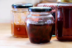 Jars with various homemade fruit jam Stock Photos