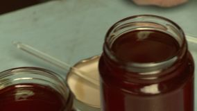 Jars Of Various Honey. Handheld, panning, close up shot of jars of different types of honey stock video