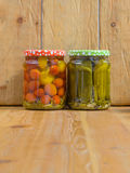 Jars with various pickled vegetables. Canned cucumbers and tomatoes. Royalty Free Stock Image