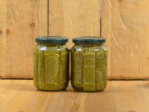 Jars of various pickled vegetables. Canned grape leaves. Stock Photography