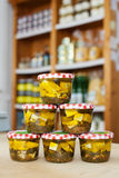 Jars of white cheese cubes and herbs in a grocery Royalty Free Stock Photo