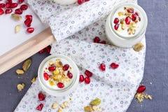 Jars with yogurt Stock Photos