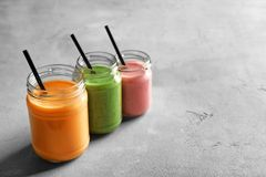 Jars with yummy smoothie. On table Royalty Free Stock Photography