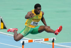 Jarvan Gallimore of Jamaica. During 400m hurdles event of the 20th World Junior Athletics Championships at the Olympic Stadium on July 11, 2012 in Barcelona Royalty Free Stock Photo
