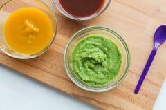 Jarzynowego puree lub dziecka jedzenie w szklanych pucharach Fotografia Stock