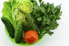 Jarzynowy ustawiający w głębokim - zielony puchar na lekkim tle zdjęcie stock