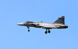 JAS-39 Gripen. Swedish supersonic fighter preparing for landing approach Royalty Free Stock Photo