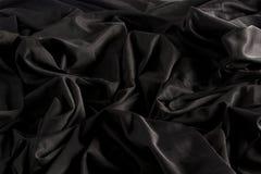 Jaskrawa czarna tkanina z czochrami i tekstura z ci??kim ?wiat?em i zmrokiem za?wiecamy fotografia royalty free