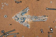 Jaskrawa lewa strzała od rygli i dokrętek Obrazy Royalty Free