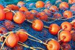 Jaskrawa sieć rybacka z pławika zbliżeniem Obrazy Stock
