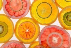 Jaskrawi świezi cytrusów plasterki, plecy lekka przejrzysta owoc Zdjęcia Stock