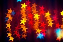 Jaskrawy abstrakcjonistyczny tło z stubarwnymi girland gwiazdami Fotografia Royalty Free