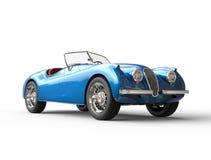 Jaskrawy błękitny rocznika samochód na białym tle Obrazy Stock