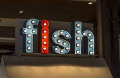 Jaskrawy barwiący znak, reklamuje ryba obrazy royalty free