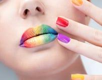 Jaskrawy manicure i makijaż fotografia royalty free