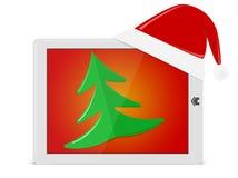 Jaskrawy ochraniacz z Santa kapeluszem i xmas drzewem. Jak ipade komputer osobisty Obrazy Stock