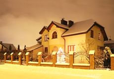 Free Jaslo, Poland - 3 1 2019: Modern Design Of A Small Single-family House Cowered A Snow Located In A Rural Area In Winter Season. Royalty Free Stock Image - 135937576