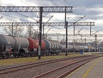Jaslo, Poland - march 30, 2018: Train on a railway station. Transport system. Freight and passenger transportation. A work on a ra royalty free stock image