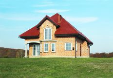 Jaslo, Poland - 7 8 2018: Modern design of a small single-family house located in a rural area. Designing buildings and landscape. New home for people. Red royalty free stock photo