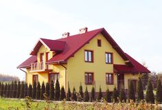 Jaslo, Poland - 7 8 2018: Modern design of a small single-family house located in a rural area. Designing buildings and landscape. New home for people. Red stock image