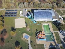 Jaslo, Poland - Oct. 15 2018: MOSiR Municipal Sports Complex with an indoor swimming pool with a waterslide and sports fields. Mod stock images