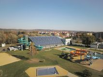 Jaslo, Poland - Oct. 15 2018: MOSiR Municipal Sports Complex with an indoor swimming pool with a waterslide and sports fields. Mod royalty free stock images