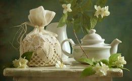 Jasmine. Aromatic jasmine tea on the sunlit board Stock Photography