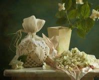 Jasmine. Aromatic dried jasmine tea on the board Royalty Free Stock Photos