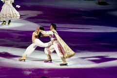 Jasmine and Aladdin Disney on Ice. Jasmine and Aladdin skate out during the finale of Disney on Ice Dare to Dream Stock Image