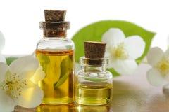 Jasmine aroma. Aroma oil bottles arranged with jasmine flowers and petals stock photo