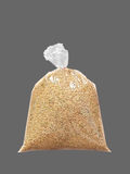 Jasmine Brown Rice in Plastic Clear Bag on Gray Background, Clipping Path Stock Photography